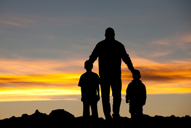 Silhouette of Father with Sons